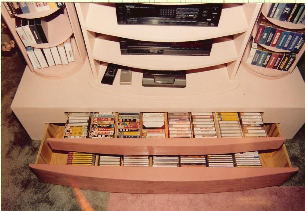 The drawers held CD's and cassette tapes while the columns held videos and DVD's