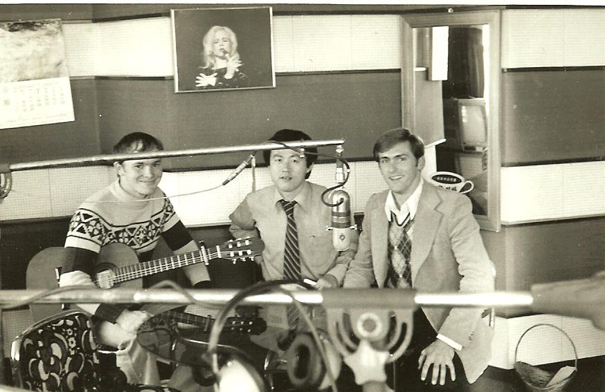 "Larry Mann (left) and I flank Hwang In-yong during the taping of a radio show where we sang ""My Leaving"" , a song written by Larry's brother, Michael."