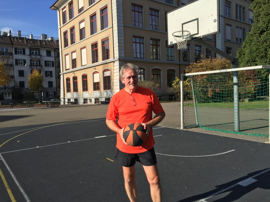 Playing basketball on a court across the street from Backeranlage Park in Zurich